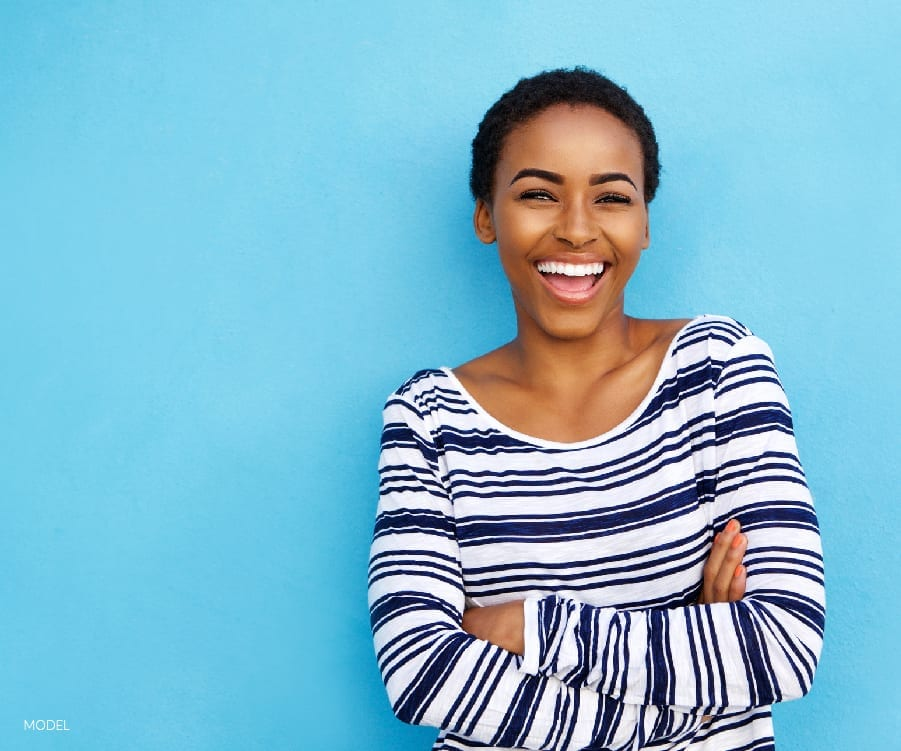 Smiling Woman with Blue Wall